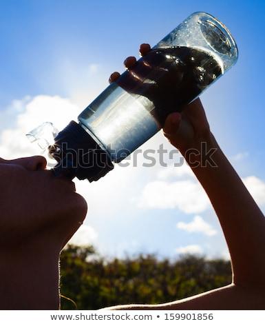 feliz · jovem · água · potável · garrafa - foto stock © deandrobot