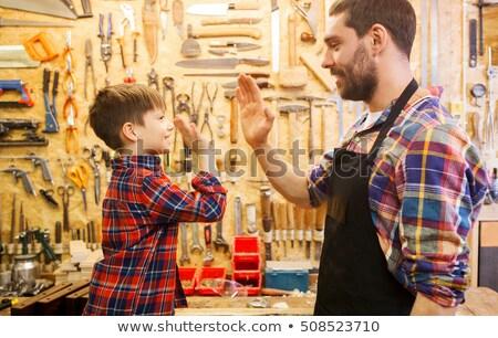 Apa kicsi fiú készít pacsi műhely Stock fotó © dolgachov