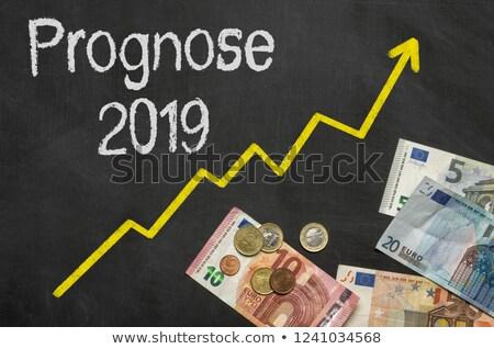 Text on blackboard with money - Forecast 2019 Stock photo © Zerbor