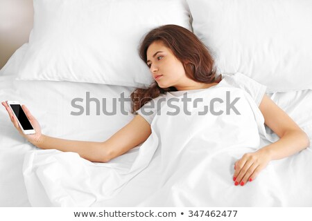 Girl Snoozing Alarm On Cellphone Stock photo © AndreyPopov