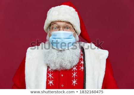 portrait of santa claus wearing glasses standing  Stock photo © feedough