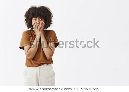 retrato · assustado · jovem · cabelos · cacheados · olhando · câmera - foto stock © deandrobot