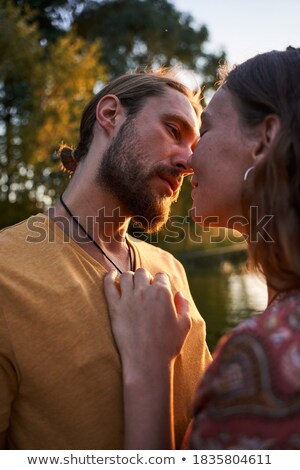 Romantic hippy couple man and woman smiling, and hugging each ot Stock photo © deandrobot