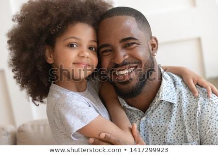 gyermekkor · szeretet · boldogság · család · bent · portré - stock fotó © Lopolo