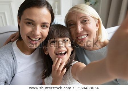 Vicces portré nő lánygyermek néz kamera Stock fotó © Kzenon