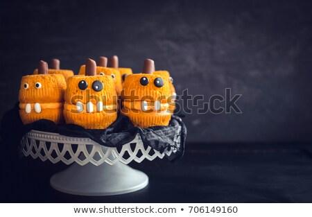 halloween cupcakes with cream ad pumkin decorated Stock photo © adrenalina