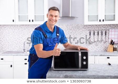férfi · technikus · javít · sütő · érett · konyha - stock fotó © andreypopov