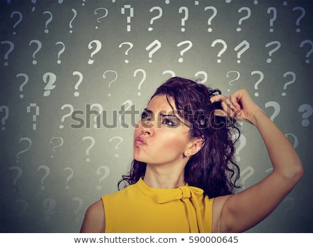 confused thinking woman seeking a solution looking preoccupied has many questions Stock photo © ichiosea