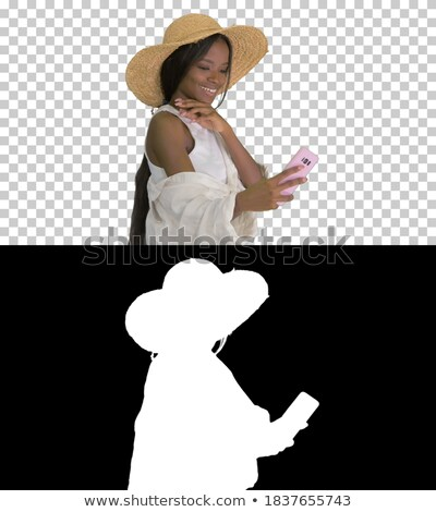 Photo of beautiful african american woman taking selfie while hu Stock photo © deandrobot
