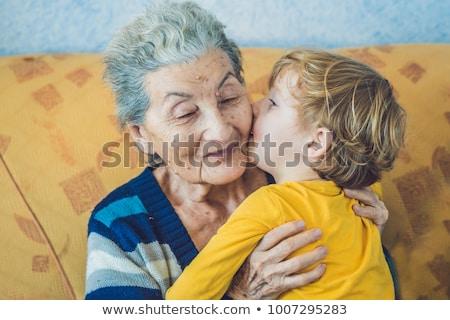 Portré vidám fiú csók boldog nagymama otthon Stock fotó © galitskaya