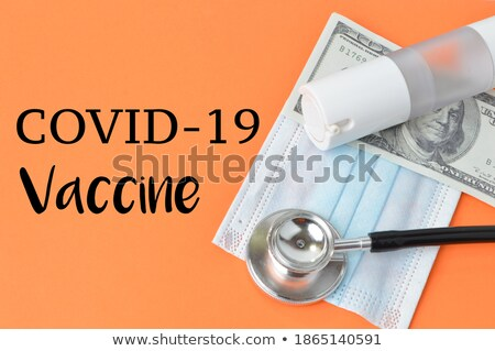 Microscope over doctor hands background. Stock photo © Kurhan