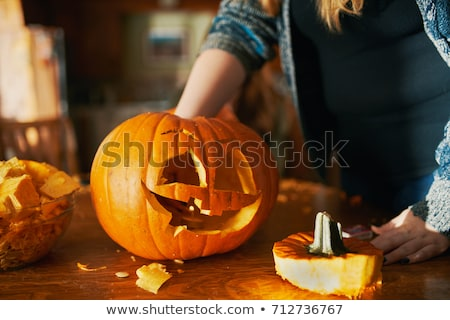 close up of halloween pumpkins on table Stock photo © dolgachov