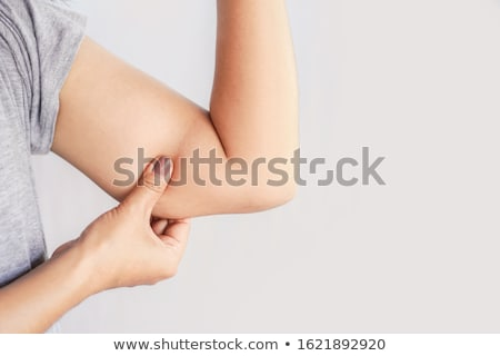 Nő tart kar túlzás kövér közelkép Stock fotó © AndreyPopov