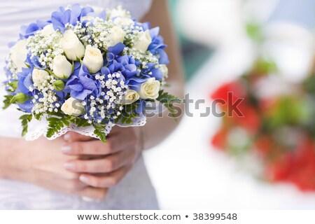 Menyasszony fehér ruha virágcsokor rózsák zöld fű virágok Stock fotó © ElenaBatkova