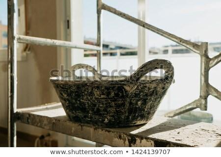 Barwiony kamieniarstwo wiadro pracy Zdjęcia stock © nito