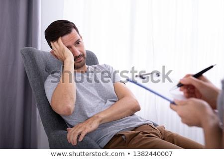 Psycholoog vergadering man lijden depressie vrouwelijke Stockfoto © AndreyPopov