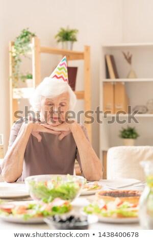 печально старший женщины рождения Cap сидят Сток-фото © pressmaster