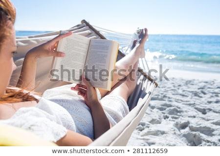 Boldog mosolygó nő olvas könyv nyár tengerpart Stock fotó © dolgachov