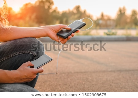 Woman Charging Mobile Phone Stock photo © AndreyPopov