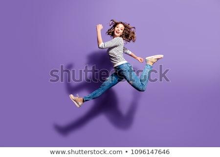 sorridente · mulher · jovem · saltando · ar · branco · menina - foto stock © dolgachov