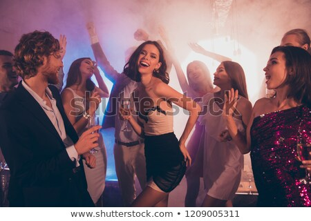 Mujer vidrio champán club nocturno celebración fiesta Foto stock © dolgachov