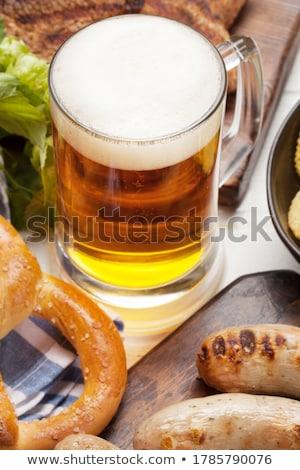 Oktoberfest establecer galletas saladas carne cerveza Foto stock © karandaev
