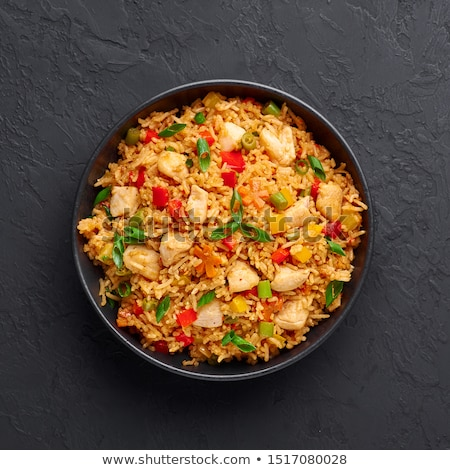Stockfoto: Fried Red Rice With Chicken Meat In A Bowl