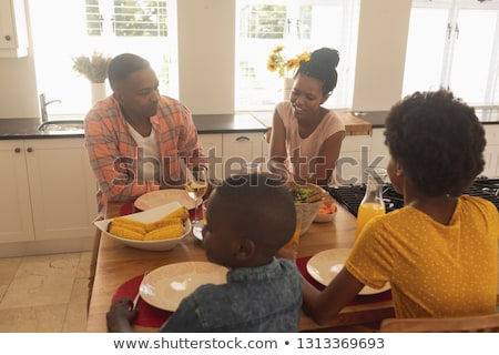 High angle view of happy African American family having food at dining table in a comfortable home Stock photo © wavebreak_media