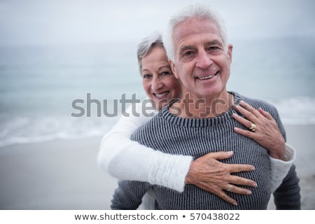 front view of active senior caucasian couple embracing each other in the park stock photo © wavebreak_media