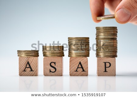 Hand Stacking Coins On Asap Letters Stock photo © AndreyPopov
