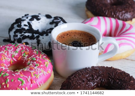 close up of glazed donuts on white table Stock photo © dolgachov