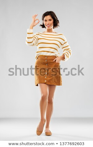 woman in pullover, skirt and shoes showing ok Stock photo © dolgachov