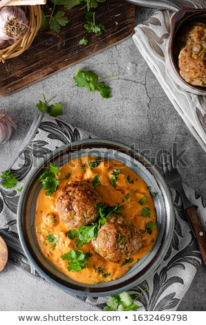 Grilled meatball with curry tomato sauce Stock photo © Peteer