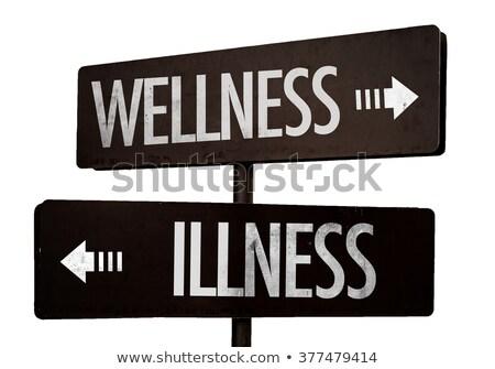 Ziekte wellness tegenover pijlen hand schrijven Stockfoto © ivelin