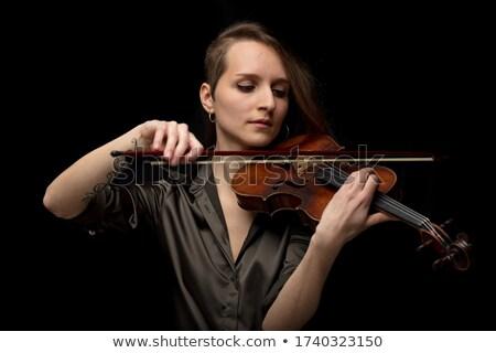 Dedicated woman playing an antique baroque violin Stock photo © Giulio_Fornasar