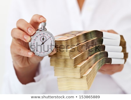 Woman with euro stacks and stopwatch Stock photo © lightkeeper