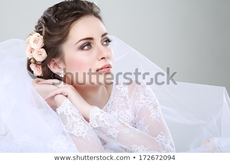 Happy young bride in wedding dress with flower decoration in hai Stock photo © HASLOO