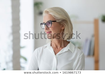 Woman observing away with eyeglasses Stock photo © photography33