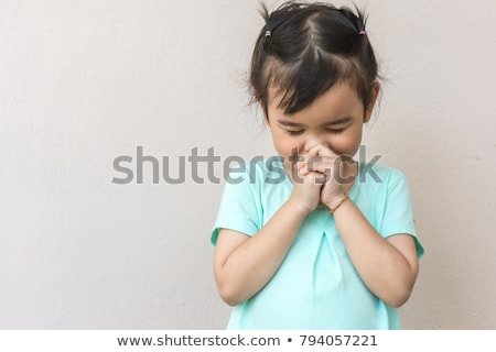 Child with hands together in prayer Stock photo © lovleah
