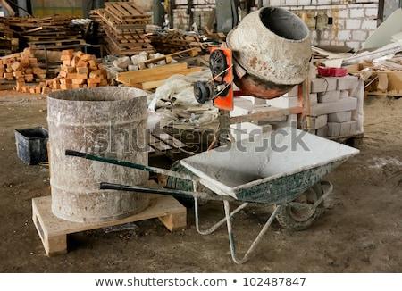 Man placing brick into wheelbarrow Stock photo © photography33