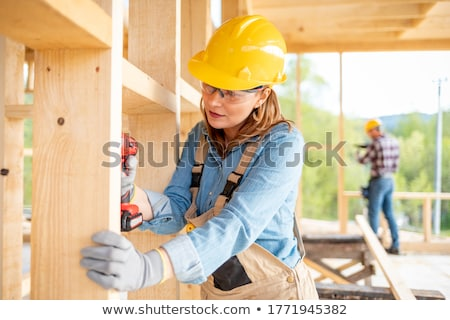 Female carpenter with wooden frame Stock photo © photography33