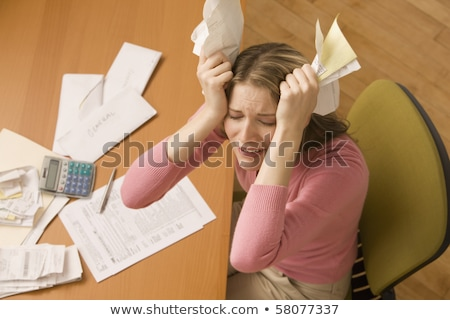 Exasperated woman with a calculator Stock photo © photography33