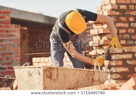 pracownik · olej · asian · uniform · kask · młodych · stałego - zdjęcia stock © photography33