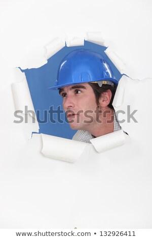 Architect peering through hole Stock photo © photography33