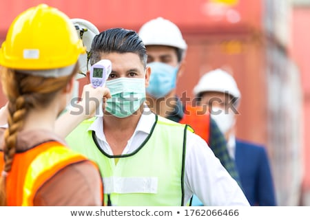 Foreman and colleague working on site Stock photo © photography33