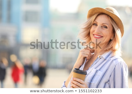Beautiful joyful mature woman background Stock photo © roboriginal