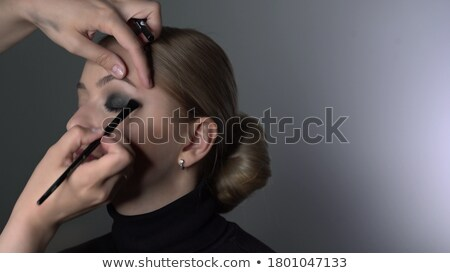 Woman making up smokey eyes with a brush Stock photo © wavebreak_media