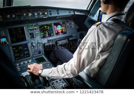 Linia lotnicza pilota uniform posiedzenia wewnątrz Zdjęcia stock © Amaviael