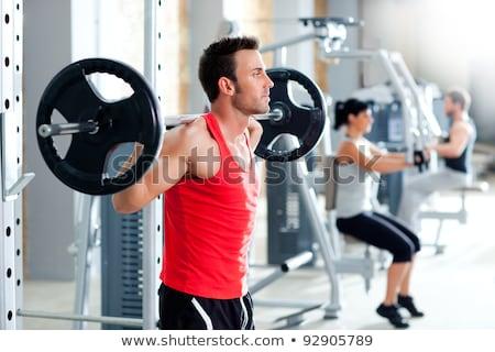 Homem equipamento esportes ginásio Foto stock © dacasdo
