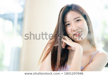 Barely dressed up attractive young lady Stock photo © konradbak